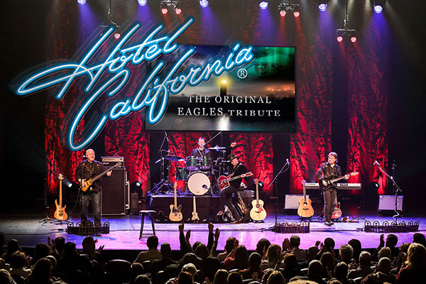 Greg Frewin - Hotel California promotional image with the band playing